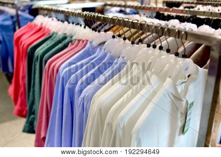 Clothes Collection In Hangers For Sale.