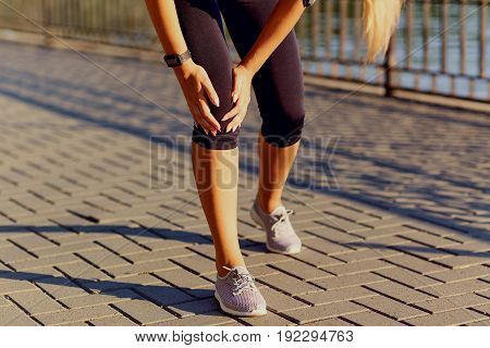 Injury of a knee on a run in a runner in the park.