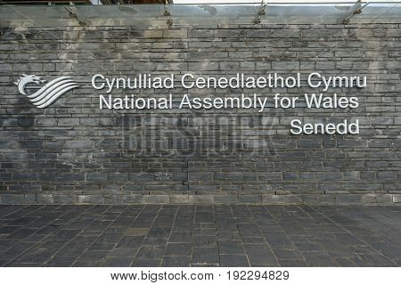 Cardiff Bay Cardiff Wales - May 20 2017: View of National Assembly signage Senedd in Welsh and English.