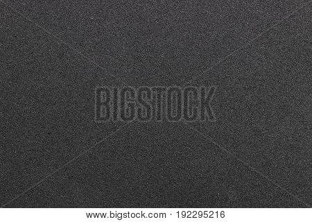Dark plastic texture with furrows Top view