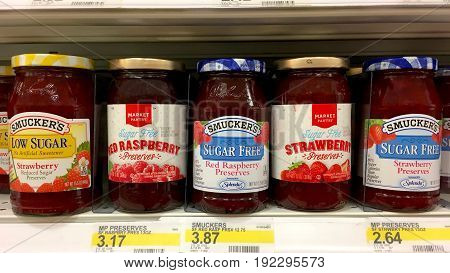 Alameda CA - January 17 2017: Grocery shelf with low calorie preserves. Market Pantry and Smucker's brands.