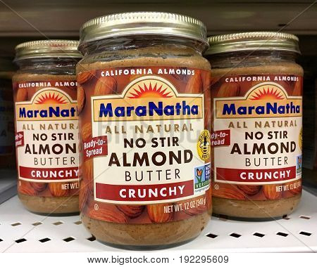 Alameda CA - January 17 2017: Grocery shelf with jars of MaraNatha brand all natural no stir crunchy Coconut Almond Butter.