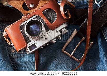 Old retro camera lies on a clothes