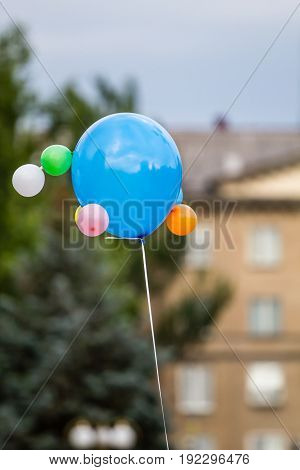 Multicolored Balloons Against The Background Of The Cityscape