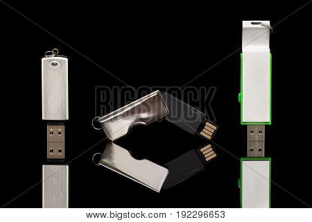 Three Usb Memory Stick In White On Black Background
