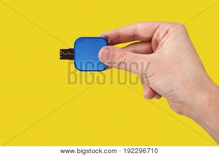 Blue Usb Flash Memory In Hand