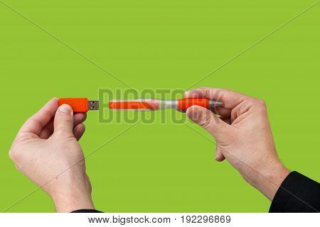 Usb Orange Flash Drive In Hand
