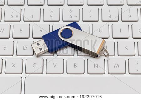 Usb Pen Drive Arranged On White Keyboard