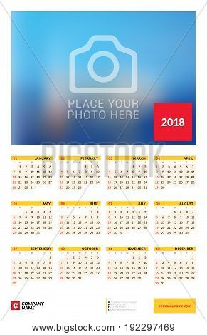 Wall yearly calendar poster for 2018 year. Vector design print template with place for photo. Week starts on Sunday. 12 months on page. Stationery design