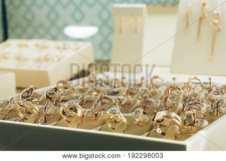 Jewelry in the shop window, Gold rings with diamonds, copy space, selective focus
