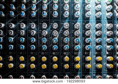 Professional Audio dj mixer console, sound tools and gear, studio equipment picture, selective focus picture of faders and knobs of mixer