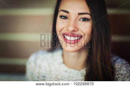 Attractive and beautiful woman with divine smile posing to camera