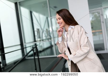 Attractive and beautiful businesswoman standing and posing in office
