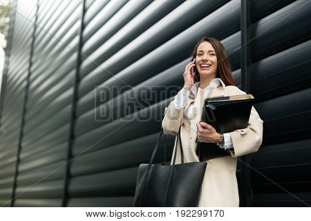 Attractive and beautiful woman in business talking on cellphone