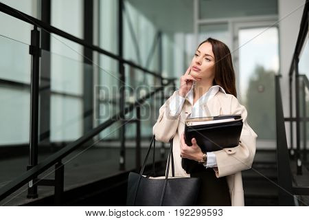 Beautiful and attractive businesswoman texting on cellphone standing