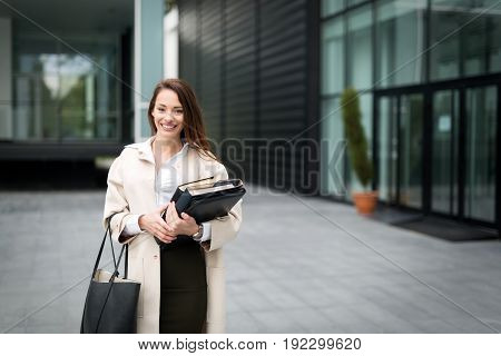 Attractive and beautiful business woman standing outdoor smiling