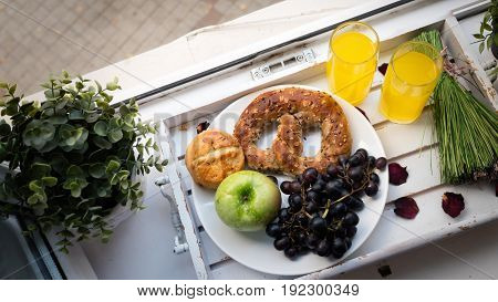 Healthy food and orange juice on plate on wooden saucer