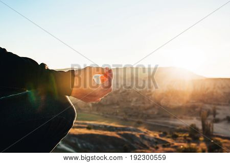 A man practices yoga at the top of the mountain at sunrise.