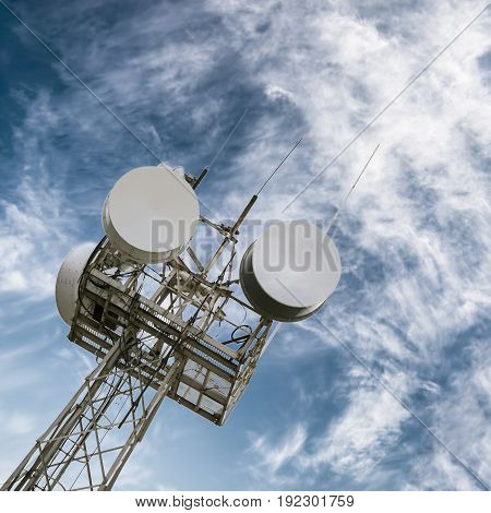 Cell tower with an antenna in red and white