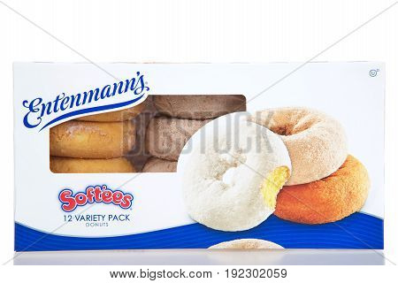 Alameda CA - April 07 2017: One box with one dozen Entemann's brand Softees Donuts. Plain cake cinnamon and powdered sugar variety pack.