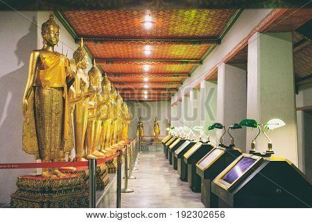 Bangkok, Thailand - December 7, 2015: Row Of Buddha statue at night in Wat Pho or Wat Phra Chetupon Vimolmangklararm, Bangkok, Thailand