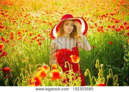 Girl In Field Of Poppy Seed In Retro Hat