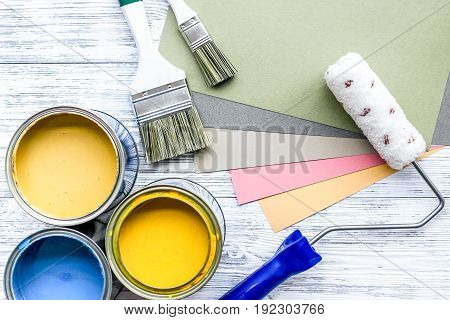 Set of tools for painting on grey wooden desk background top view.
