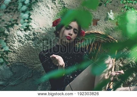 Pretty Girl With Fashionable Makeup Tying Shoe Laces
