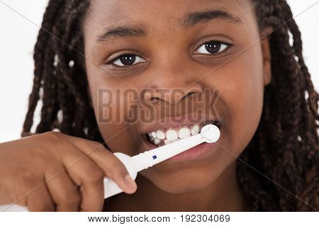 Portrait Of An African Girl Brushing Her Teeth