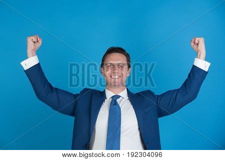 Man Smiling With Winner Gesture In Fashionable Suit