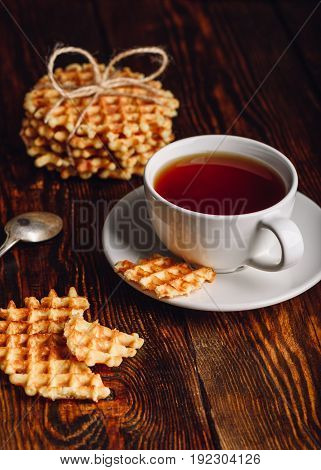 White Cup of Tea and Belgian Waffles for Dessert. Vertical Orientation.