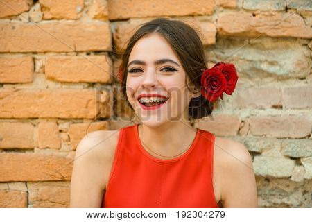 Happy Woman With Dental Braces On Teeth