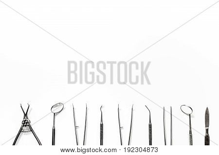 teeth care with dentist instruments in doctor's office on white background top view mock-up