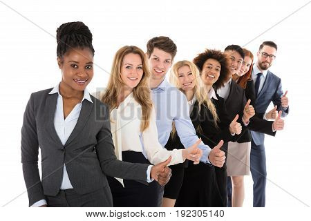 Confident Young Businesspeople Gesturing Thumbs Up Over White Background