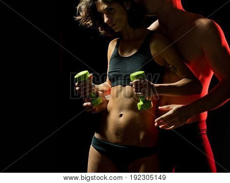 Woman And Sexy Man With Six Pack Abs With Dumbbell
