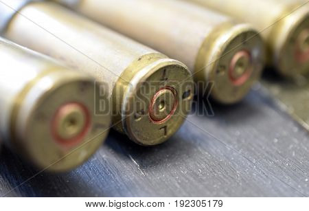 Close up of spent brass bullet casings