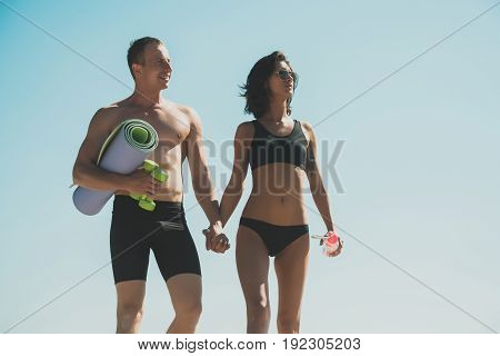 Girl With Water Bottle In Sunglasses And Man With Body