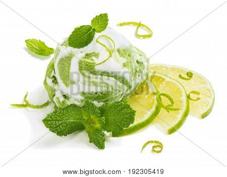 Ice cream of lime decorated with zest and mint isolated on white background.