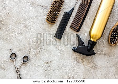 Professional hairdressing tools and accessories on stone table background top view.