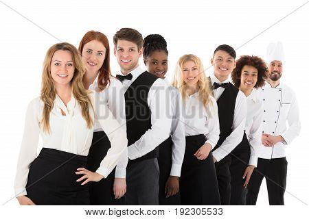 Happy Confident Restaurant Staff Standing In Row Against White Background