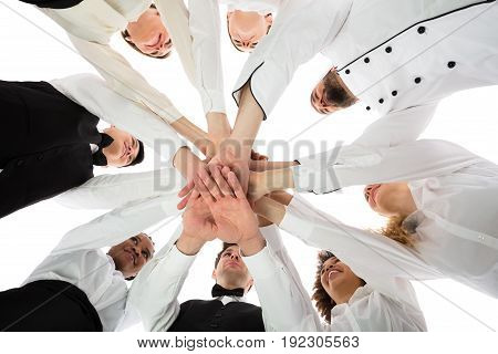 Low Angle View Of Multiracial Restaurant Staff Stacking Hands