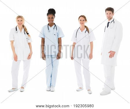 Portrait Of Happy Multiracial Medical Team In Front Of White Background