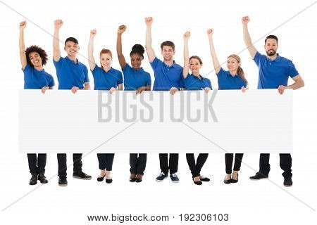 Happy Multiracial Janitors With Banner Raising Their Arms