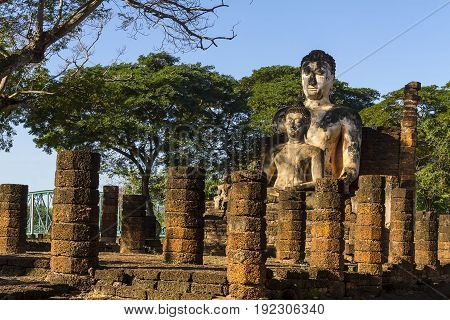 Two old sculpture buddha and sunlight at Wat Phra Si Ratanamahathat  in Sisatchanalai Historical Park, Sukhothai province Thailand