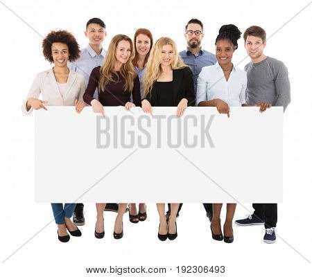 Group Of Happy Multiracial College Students Holding Long Billboard