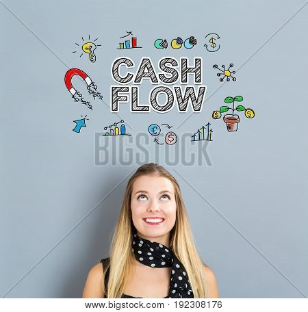 Cash Flow concept with happy young woman on a gray background