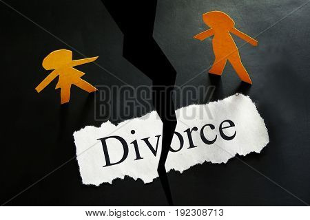torn Divorce paper with paper cutout couple