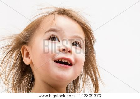 Happy Toddler girl with a big smile on white background