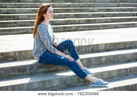 Girl Sitting On Stone Steps 01
