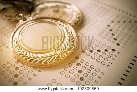 medals awards on exam test answer sheet education and winner award concept vintage tone